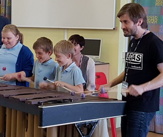 Owen Gunnell with childen at marimba